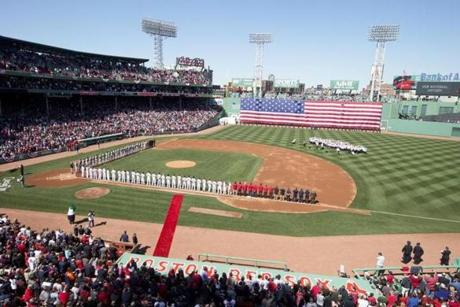 The Orioles and Red Sox lined the Fenway Park basepaths for the home opener ceremonies.